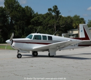 Mooney M20F N6377Q taxiing through Spruce Creek  Fly In Community in Florida